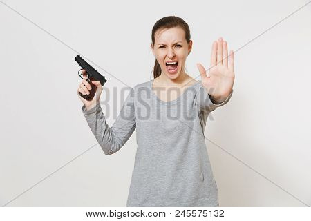Woman With Gun In Hand Showing Stop Gesture With Palm Isolated On White Background. Girl Hand No Sho