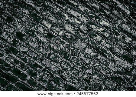 Old Shabby Dark Brick Wall Diagonal Texture. Aged Brickwork. Black Masonry. Retro Grunge Background