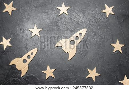 Wooden Space Rocket And Stars On A Dark Background. The Concept Of Space Travels, The Study Of Plane