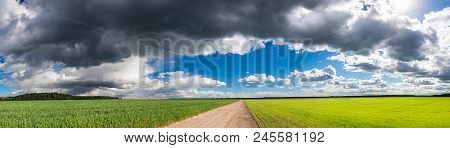 Rural Landscape View From Field And Road. Panoramic View Of Agricultural Fields With Wheat And Rye.