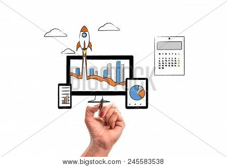 Woman Hand With Pencil Draws Rocket Launch From Pc Monitor. Pc Monitor And Tablet And Smart Phone Wi