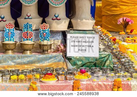 Offerings Of Butter And Flour At The Mahabodhi Temple, Bodhgaya, Bihar, India