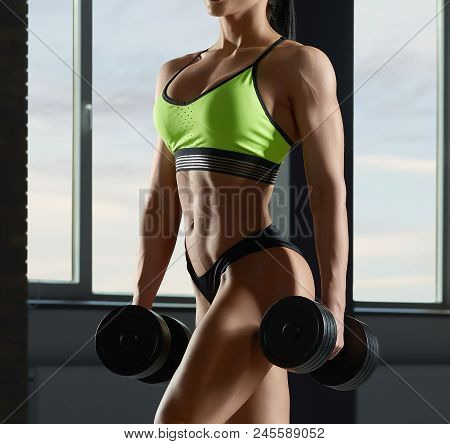 Close Up Of Strong Fit Model's Body With Muscles.