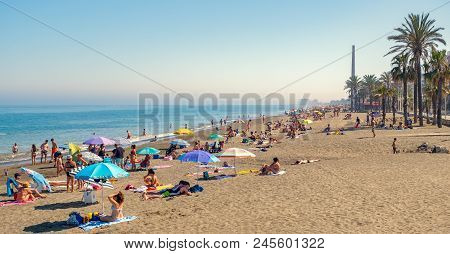 Malaga, Spain - June 15, 2018. People With Colorful Umbrellas At The Misericordia Beach, Costa Del S