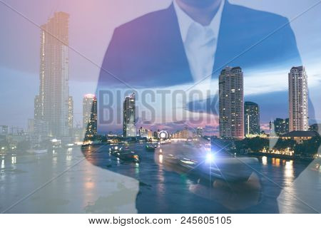 Double Exposure Businessman Hand Holding And Touch Screen Smart Phone With Modern City Background. M