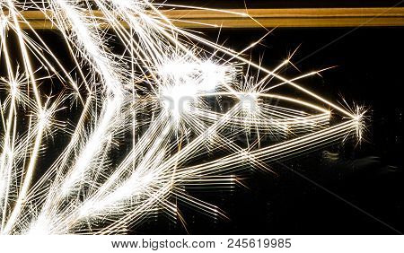 Sparks Reflected In A Mirror As They Bounce And Explode.