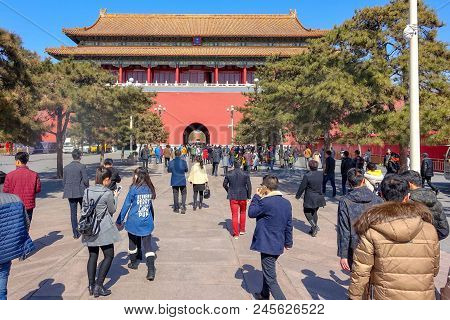 Beijing, China - March 11, 2016: Forbidden City. Tourists Across The Main Gate Go To The Forbidden C