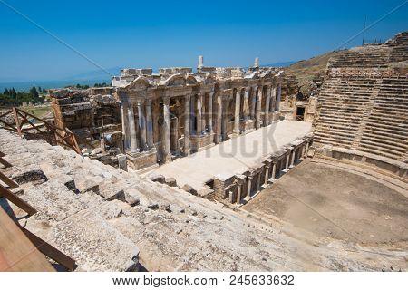 Roman amphitheatre in the ruins of Hierapolis, in Pamukkale, near modern turkey city Denizli, Turkey.