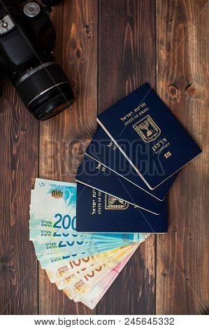 Fan Of Two Hundred Israeli Shekel Bills Together With Israeli Passport On A Black Background