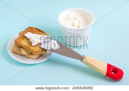 Breakfast Of Cream Cheese With Toast. Spatula As Table Knife. Minimal Style. Creative Idea, Imaginat