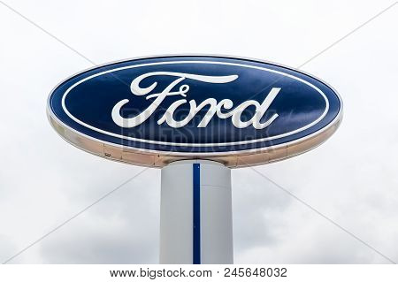 Ford Automobile Dealership Exterior And Trademark Logo