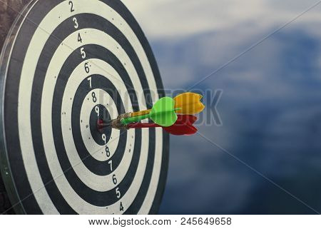 Shot Three Dart Arrow In Center Of Dartboard. Concept To Target Success And Winner