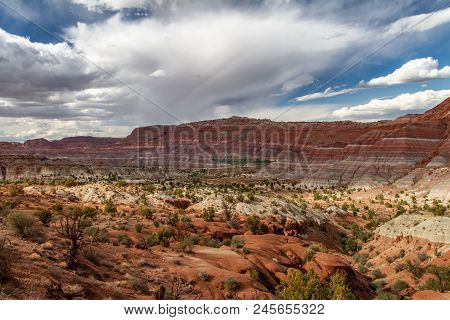 Magnificent Rainbow Layers And A Gorgeous Cloudy Sky In Grand Staircase-escalante National Monument