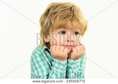 Small Boy In Green Shirt. Boy Holds Face On Hands. Boy Waiting. Close Up Portrait. Fashionable Littl