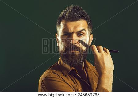 Barbershop Ads Concept. Bearded Barber With Straight Razor Near Beard. Barbershop Equipment. Hipster