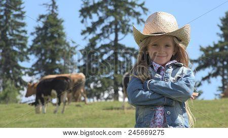 Cowherd Child Pasturing Cows, Grazing Cattle, Shepherd Girl In Cowboy Hat