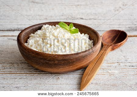 Ricotta Cheese, Curd Cheese, Farmers Cheese Or Tvorog In Wooden Bowl. Selective Focus. Concept Of He