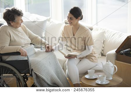 Disabled Woman With Medical Assistant