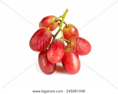 Fresh Red Seedless Grapes Isolated On White Background