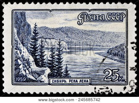 Luga, Russia - June 07, 2018: A Stamp Printed By Russia (ussr) Shows Beautiful View Of The Lena Rive