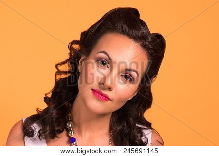 Beautiful Brunette With Hairdo And Make Up In Studio, Pin Up Style, Close Up Portrait