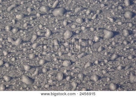 This photograph shows frozen raindrops on a metallic background. I think it became an unique abstract / background poster