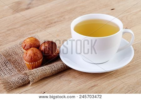 White Cup Of Tea With Cookies On A Wooden Background White Cup Of Tea With Cookies On A Wooden Backg