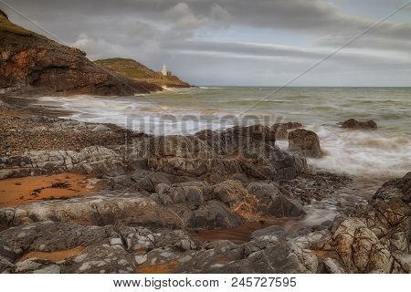 Blue Flag And Seaside Award Winning Bracelet Bay Beach Near Mumbles Lighthouse On The Gower Peninsul