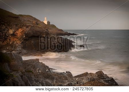 Mumbles Lighthouse And Bracelet Bay On The Gower Peninsula In Swansea, South Wales, Uk.