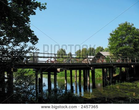 Wooden Bridge And Bicycles