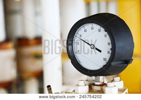 Pressure Gauge Using Measure The Pressure In Production Process. Worker Or Operator Monitoring Oil A