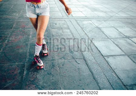 A Picture Of Well-built And Slim Legs Of Girl. She Is Posing On Camera. Girl Is Keeping Right Leg Be
