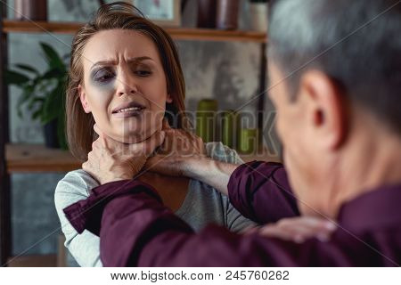 Strangling Wife. Crazy Drunk Alcohol Addicted Husband Strangling His Young Wife With Damaged Eye At