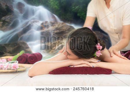 Sap Massage In Waterfall Nature.  Masseur Doing Massage With Treatment Sugar Scrub On Asian Woman Bo