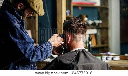 Barber With Clipper Trimming Hair Of Client, Rear View. Working Process Concept. Barber With Hair Cl