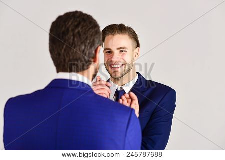 Man With Happy Face In Jacket Listening His Business Partner. Business And Friendship Concept. Succe
