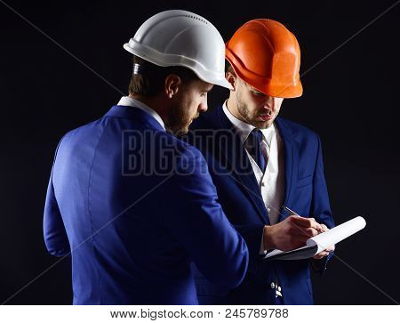 Builders Think About Engineering Project. Business People, Engineering, Business, Building Concept.