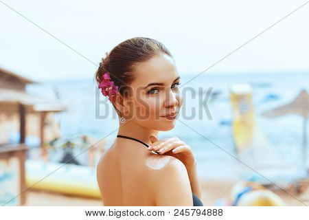 Attractive, Young Woman With Healthy Skin Applying Suncream. Young Woman Apply Sun Lotion On Summer
