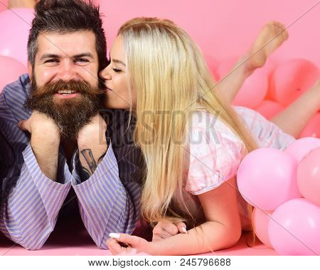 Blonde On Smiling Face Kissing Bearded Macho, Fall In Love. Love Concept. Couple In Love In Pajamas
