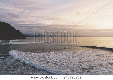 Sunlight Sunset On Horizon Ocean On Background Seascape Rays Sunrise. Relax View Waves Sea On Evenin