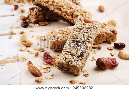 Close Up Of Fitness Food Power Bar With Different Kinds Of Mixed Nuts. Vegetarian Sweets With No Har