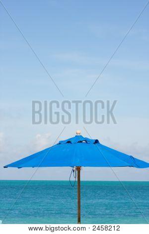 Blue Sea Sky And Umbrella