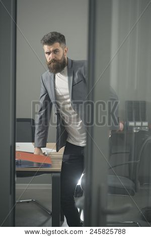 Bearded Man Look Out Room Door. Businessman In Modern Office With Glass Walls. Confident Man In Casu