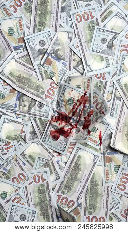 Pile Of Money With Bloody Spot, Top View. Dirty Money Concept. Dirty Criminal Profit. Dollar Marked