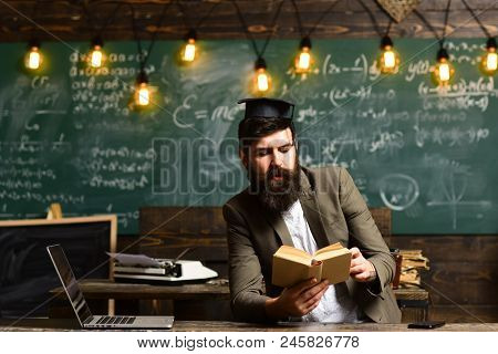 Bearded Man Read Book In Classroom. Scientist Hipster With Book On Chalkboard. Businessman In Suit R
