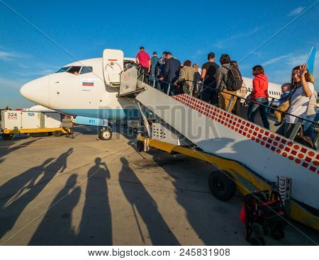 Moscow, Russia - April 19, 2018: Passengers boarding on the aircraft of low cost airline company Pobeda