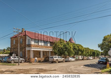 Ladybrand, South Africa - March 12, 2018: A Street Scene With An Historic Building And Vehicles In L