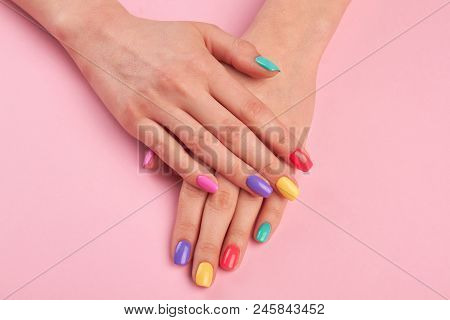 Female Hands With Colorful Polish Nails. Woman Well-groomed Hands With Multicolor Nails On Salon Tab