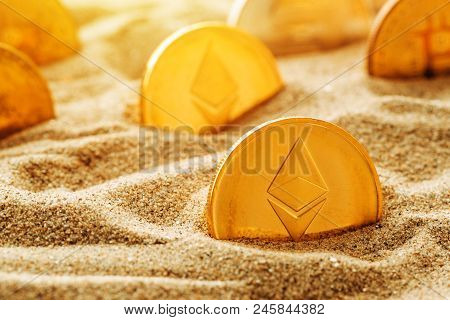 Golden Ethereum In Sand, Conceptual Image For Lost And Found Valuable Cryptocurrency Coins That Are