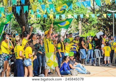 Excited People Watching A Match From The Brasil Team At World Cup 2018